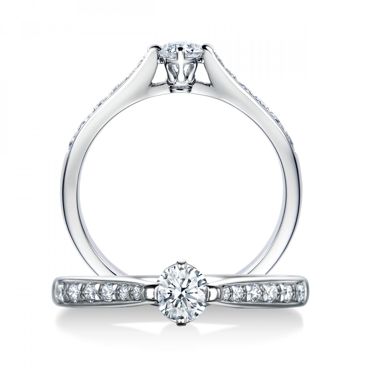 センターダイヤモンドを包み込む台座の側面にブランドのアイコン「クラウン」をデザインに取り入れ、細部にまでこだわった新作 ジュエリーライン。