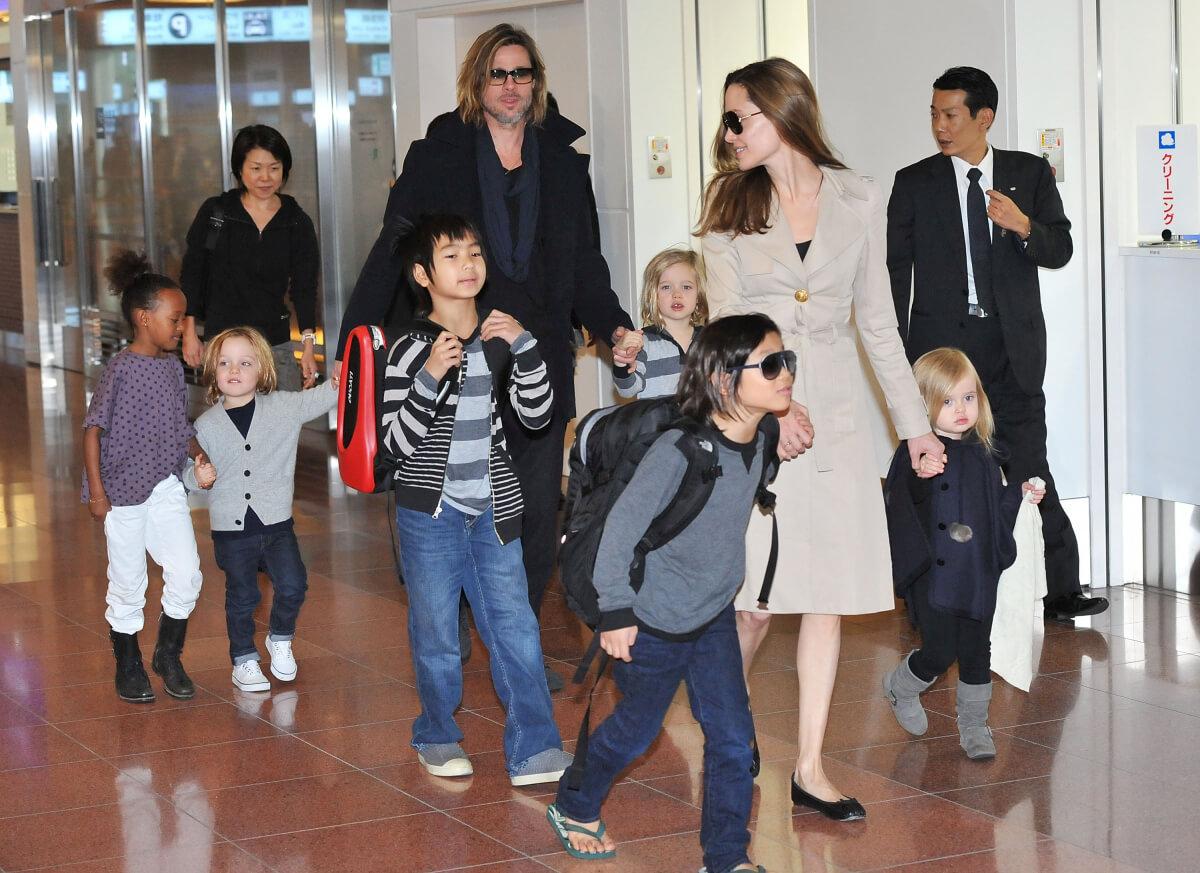 2011年、『マネーボール』のジャパン・プレミアのために来日したアンジェリーナ・ジョリーと家族たち。