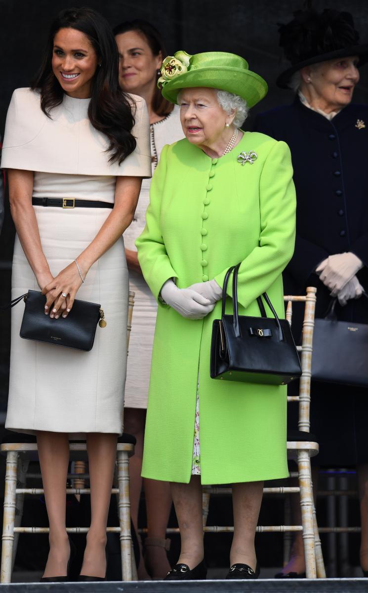 単なる偶然か、合わせたのか、ふたりともバッグとシューズをブラックで統一している。Photo:Getty Images