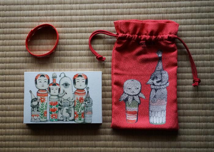 大正14年創業の京都の老舗 「谷口松雄堂」とのコラボによるご朱印帳。丹後ちりめんの巾着付き「こけし」¥5,800