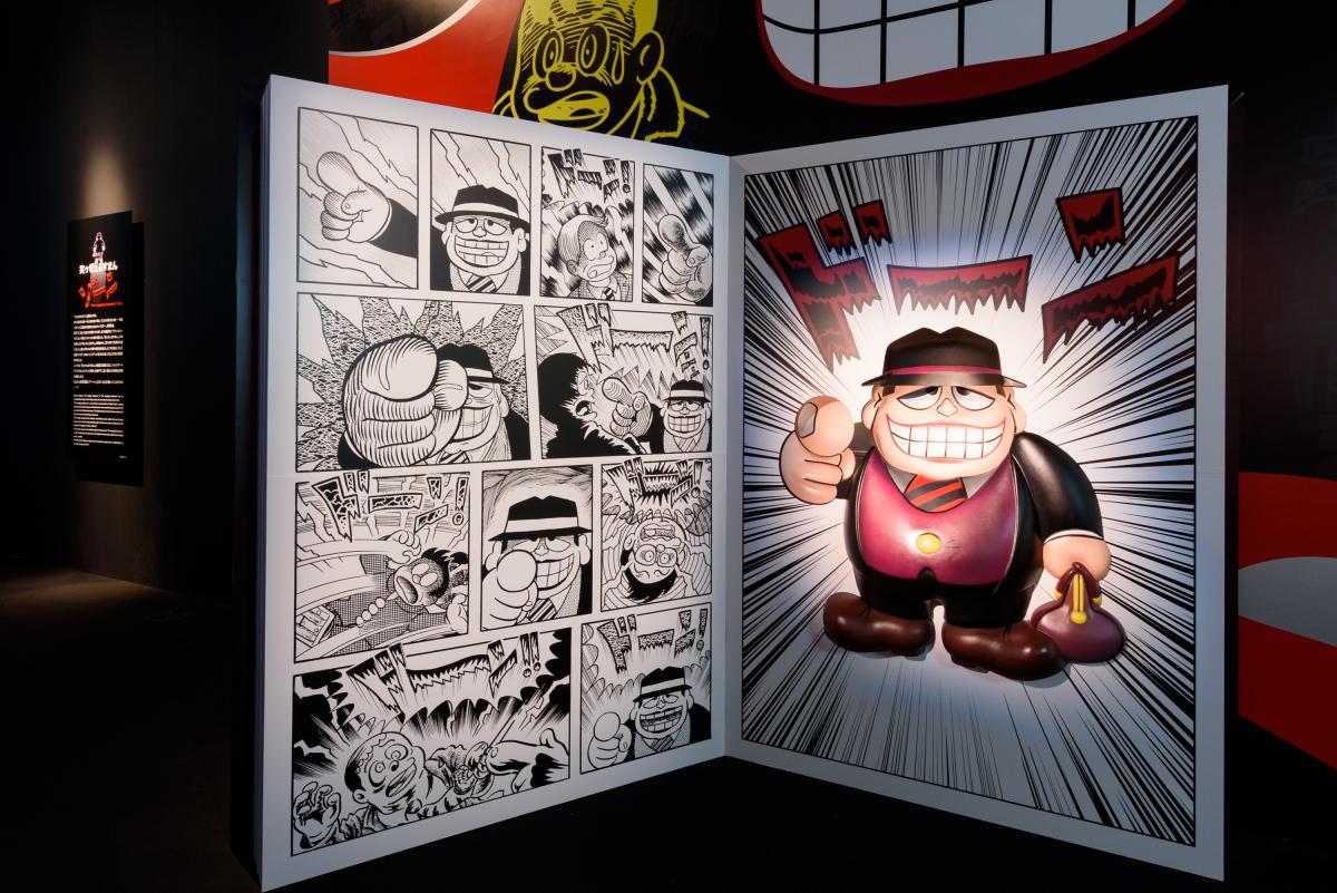 2018年に誕生50周年を迎えた『笑ゥせぇるすまん』の貴重な生原稿のほか、漫画作品を1話丸ごと楽しめる「笑ゥせぇるすまん」ゾーンも。Ⓒ藤子スタジオ