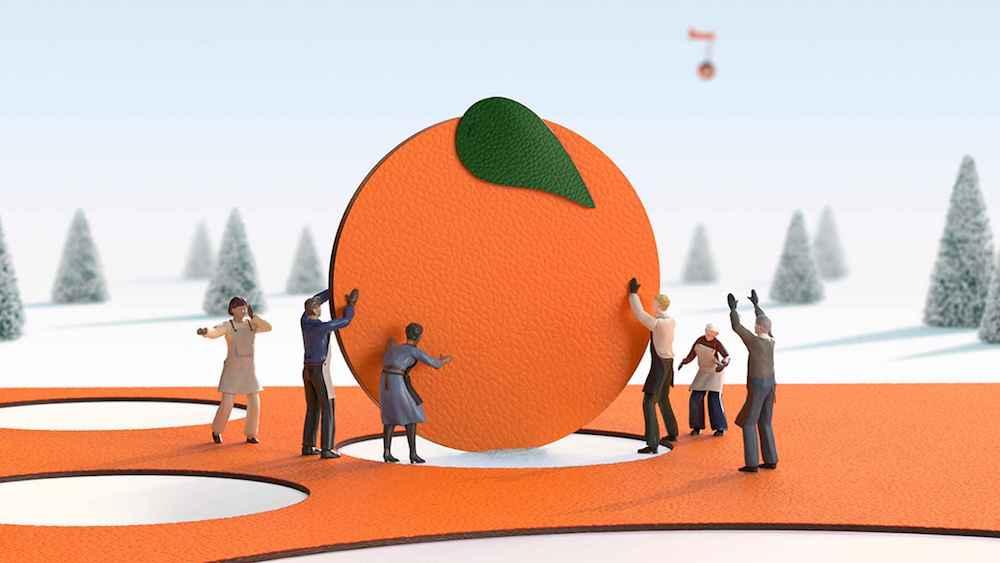 可愛らしい職人たちがオレンジにメッセージを刻印してくれる。