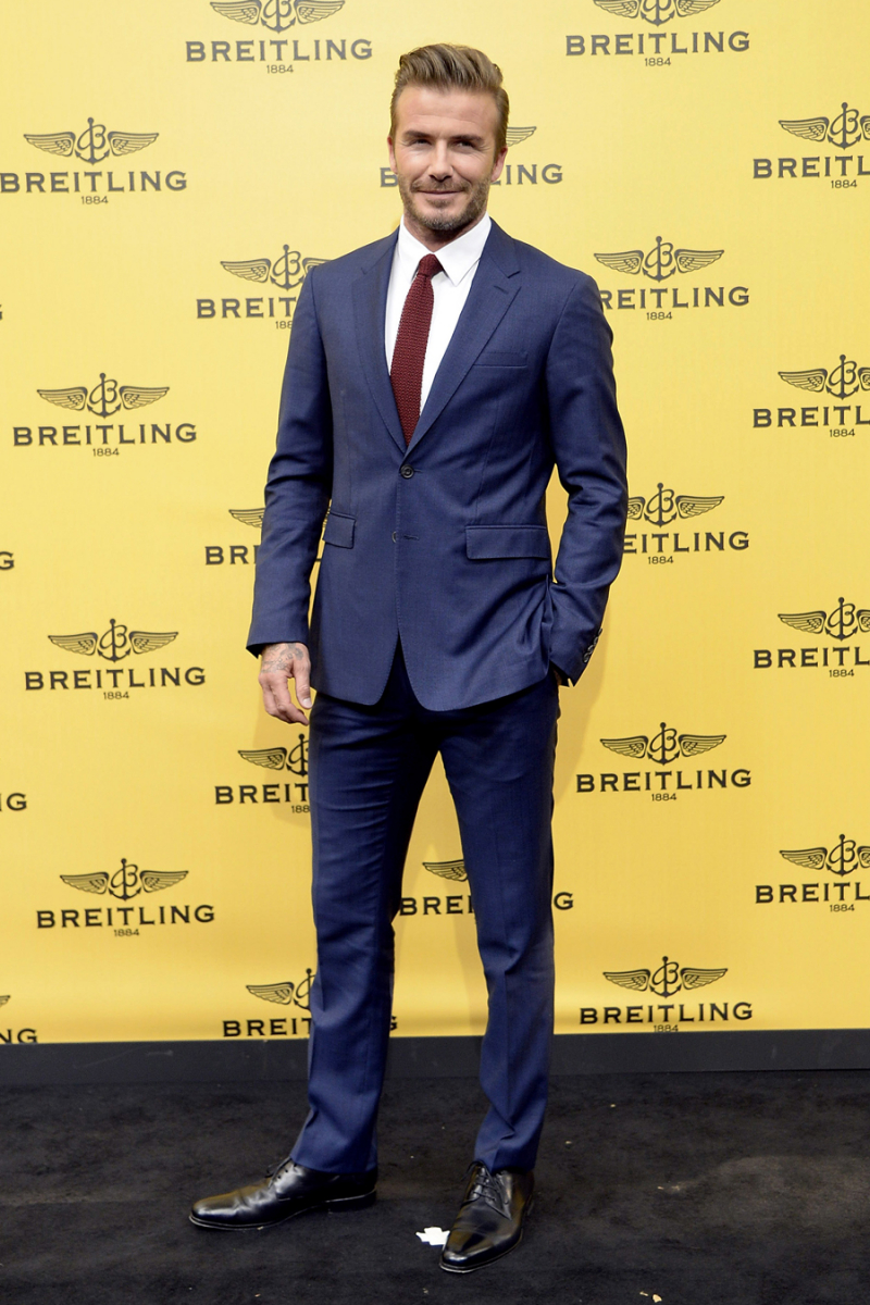 【2011〜2015年:ベッカムスタイル確立期】2015年6月、スペイン・マドリードで開催されたブライトリングのブティックオープンパーティにて。英国紳士を感じさせるスーツスタイルに、20代のチョイワル風デヴィッドの面影なし。