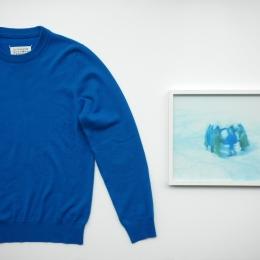 青いセーターと横浪さんの写真